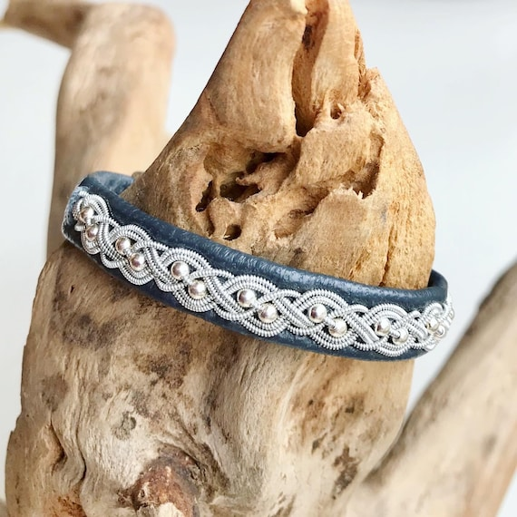 Sami charcoal blue reindeer leather bracelet with sterling silver beads and a magnetic clasp.