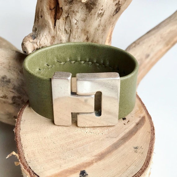 Light shimmering olive reindeer leather cuff with a magnetic clasp.
