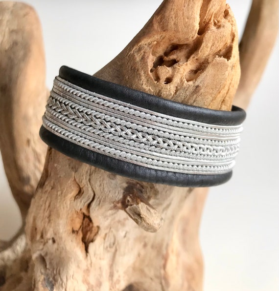 Traditional Scandinavian leather cuffs, with pewter threads braids and a shed antler button.