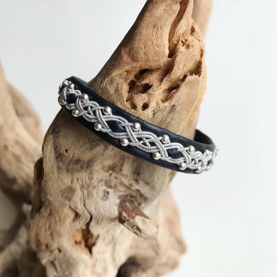 Sami black reindeer leather, sterling silver beads bracelet with a magnetic clasp.
