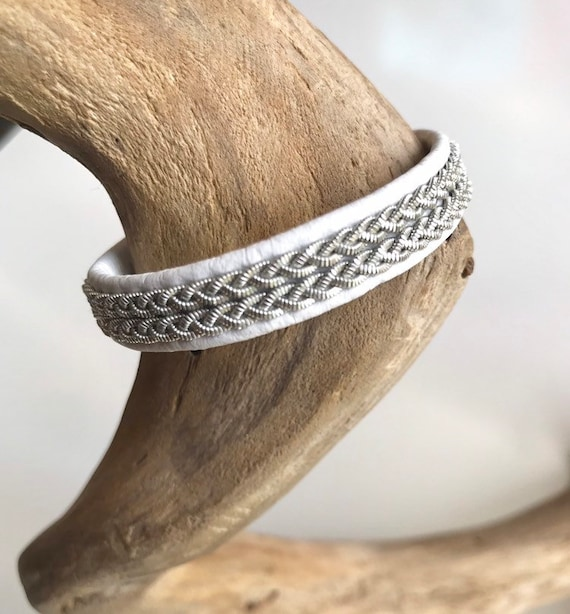 Traditional Nordic Sami reindeer leather bracelets with 2 rows of flat pewter braids.
