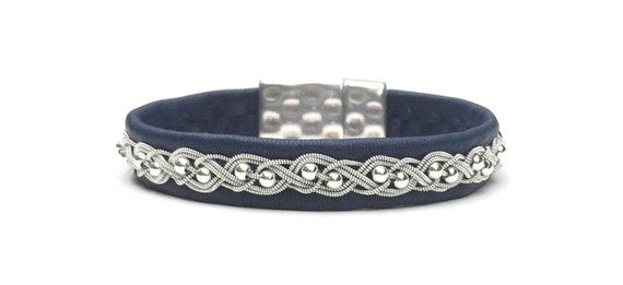 Swedish reindeer leather braided bracelet with sterling silver beads.