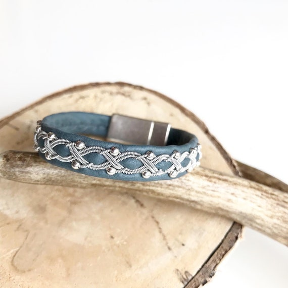 Grey-blue reindeer leather bracelet with traditional pewter braiding and sterling silver beads.