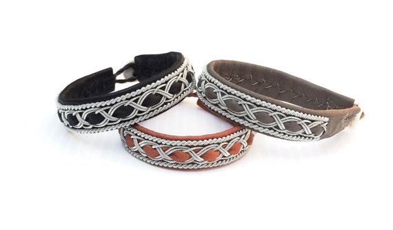 Traditional Sami reindeer leather bracelet, with borders of silver and pewter.