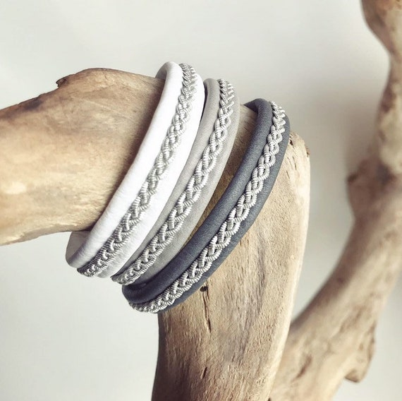 Traditional Scandinavian reindeer leather bracelet with a braid of flat pewter.