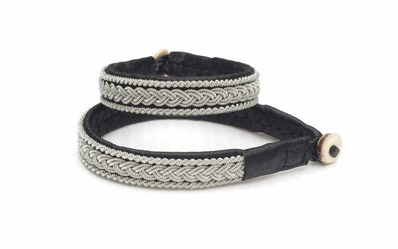 Traditional Sami reindeer leather bracelets with pewter braid and twisted borders.