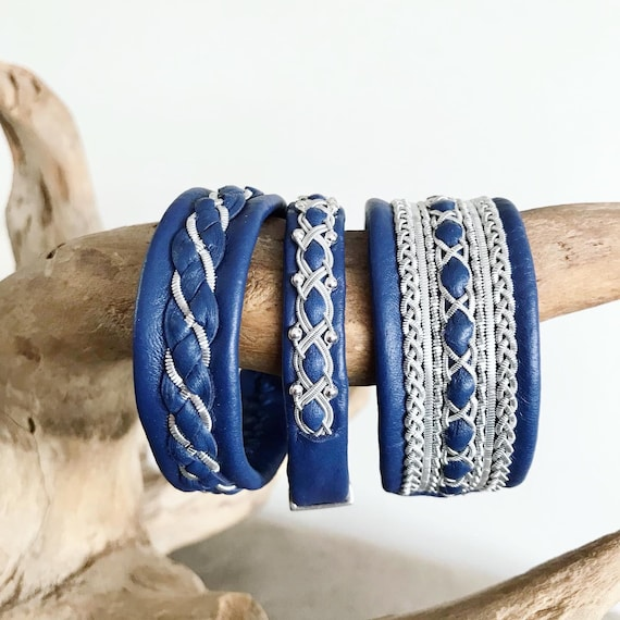 Blue reindeer leather bracelets with pewter and silver threads.