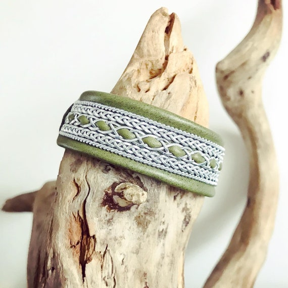 Traditional Scandinavian leather cuffs, with pewter thread braids.