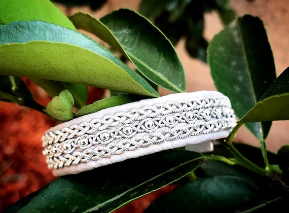 Scandinavian reindeer leather bracelets, sterling silver beads row with traditional flat pewter braid borders.