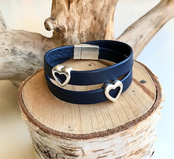 French navy wrap around reindeer leather bracelets with a magnetic clasp and two heart sliders.