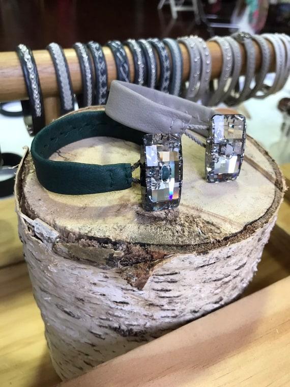 Swedish reindeer leather bracelets with big Swarovski crystal buttons.