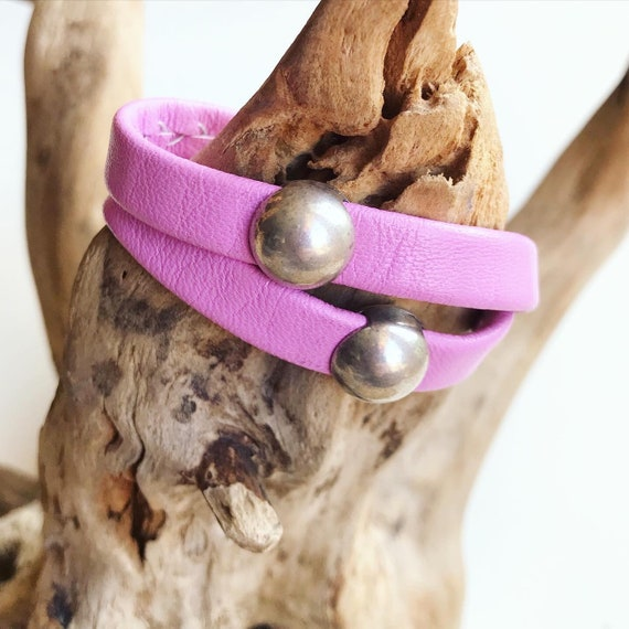 Pink wrap around reindeer leather bracelet with a magnetic clasp and two dome sliders.
