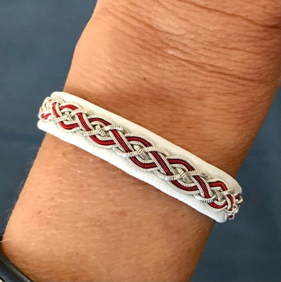 Traditional Sami reindeer leather bracelets with pewter and copper threads.
