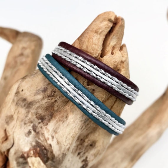 Pewter bracelets in maroon or petroleum coloured leather.