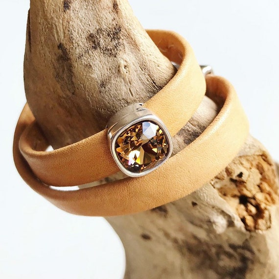Natural Swedish reindeer leather bracelets with magnetic clasp and a square light smokey Topaz Swarovski slider.
