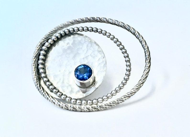 Blue Topaz Brooch Hammered Silver Swirls