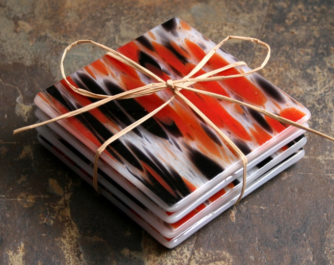 Fused glass coasters. 'Vampire Dreams - Opaline' A set of 4 sturdy coasters, made in stunning 'splashes' of reds and black on a white base.