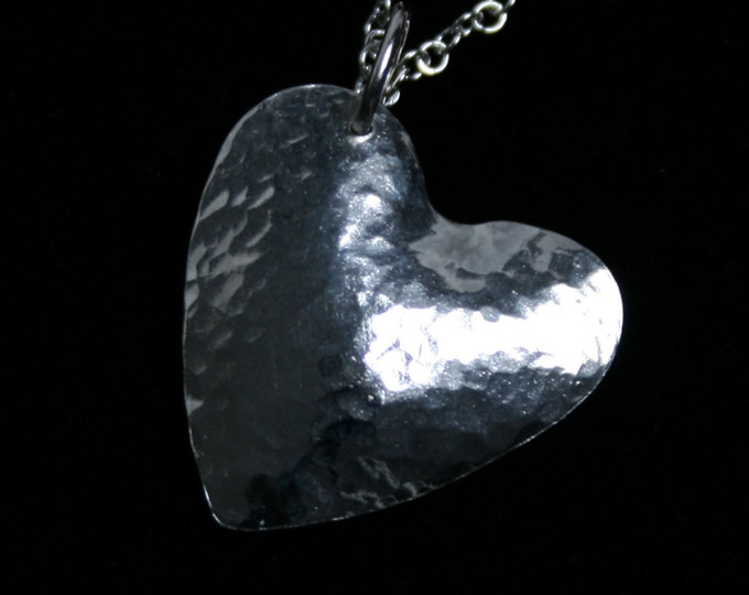 Handmade 'Amore ~ Monad' pendant. Traditionally hand made Sterling Silver heart pendant with a hammered finish for extra sparkle.
