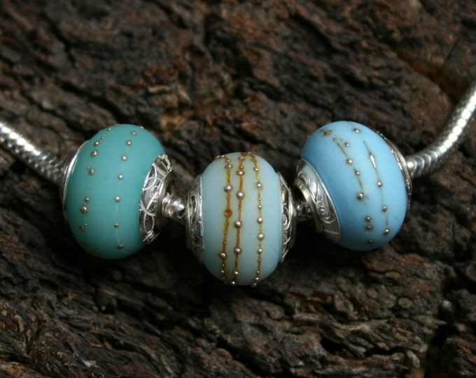 Bali Seas ~ 3 lampwork big hole beads. Hand made full sterling silver core & end caps. Fine silver wrapped, etched. Organic Ocean Blues.