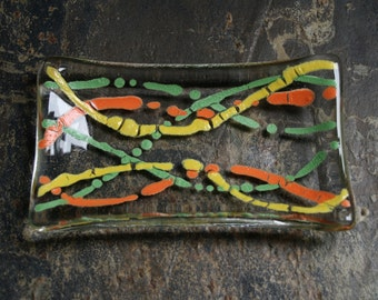 Serpentine series 'Fruity!'  (D2)    Fused glass soap / trinket / mini sushi / chocolates dish in Orange, yellow and green on a clear base.
