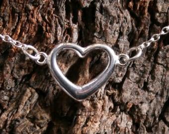 Eternally Loved - Discrete PERMANENTLY LOCKING Heart shaped O ring Slave Bracelet. Sterling silver. BDSM eternity / infinity ring bracelet.