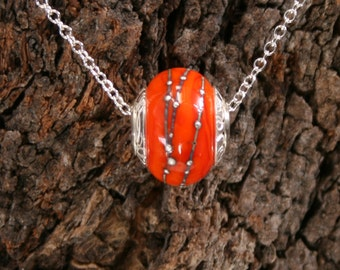 African Sunset ~ Lampwork big hole Focal bead. Hand made full sterling silver core & end caps. Fine silver wrapped. Organic. Vibrant Orange