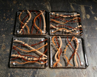 Fused glass coasters. 'Serpentine - Earth'  Shades of brown on a clear base. Squiggly coasters. Choose 2 or 4. Can be customized.