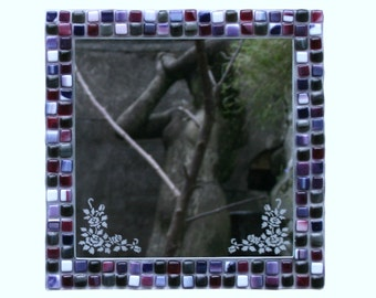 Purple Rose, mosaic series, fused glass mirror etched with roses and framed in a range of purples and deep pinks.