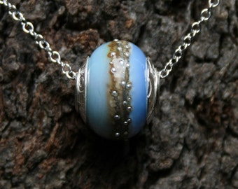 Oceana ~ Lampwork big hole Focal bead. Hand made full sterling silver core & caps. Fine silver wrapped. Organic. Translucent warm sea blues