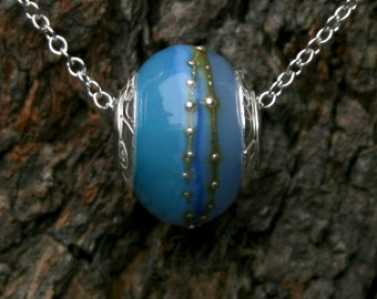 Tahiti ~ Lampwork big hole Focal bead. Hand made full sterling silver core & caps. Fine silver wrapped. Organic. Translucent warm sea blues.