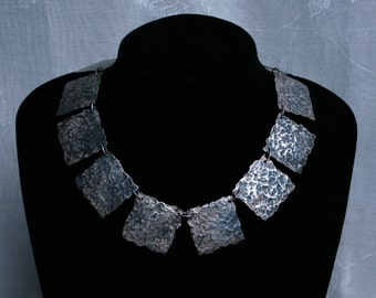 Traditionally made 'Cleo' necklace. Hammered finish with patina. Fully UK Hallmarked Eco-friendly Sterling 925 Silver. Recycled silver.