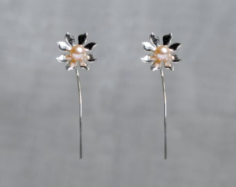 Handmade 'Ma Petite Fleur' earrings. Traditionally hand made sterling silver flower earrings with peach pearls, stud style with stem