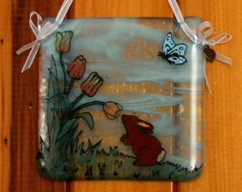 Hand painted, fused glass hanging ornament. 'Smell the flowers' Cute bunny rabbit and tulips design 10x10cm / 4x4 inches plus hanging ribbon