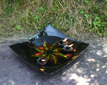 """Tribal Dances - Large, exclusive, fused glass bowl in glossy black with a red and yellow tribal pattern. 30 x 30 x 7 cm approx. 12 x 12 x 3"""""""