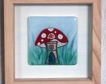 "Shroom House - Framed Kiln Fused art glass painting. Fairy Toadstool House. Natural wood frame. Glass wall art. 19 x 19cm (7.5 x 7.5"")"