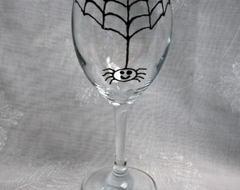 Incy Wincy Spider - An exclusive design, hand painted, happy, drunken spider hanging from his web!  On a wine glass.