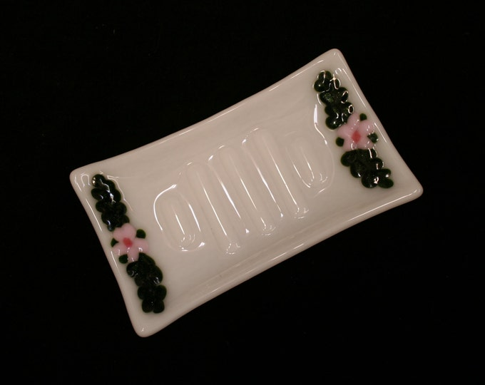 Fused glass soap dish 'Flora in Pink' - Unique, hand made, featuring raised pink flowers and sparkly green leaves on a white ribbed base.