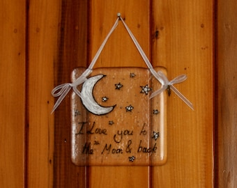 Hand painted, fused glass hanging ornament. 'I love you to the Moon & Back' Moon, stars and wording 10x10cm / 4x4 inches plus hanging ribbon