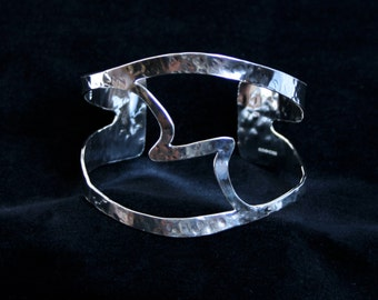 Wide cuff bracelet. 'Harmony' Traditionally hand made with a unique selectively hammered finish. Fully UK Hallmarked Sterling Silver