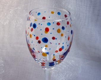 Polka Dot - Multi - An exclusive design, hand painted, wine glass featuring multi coloured polka dots encircling the bowl.