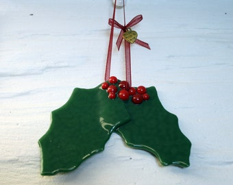 Hanging Holly - Fused glass Festive hanging Yuletide Christmas tree/ window/ wall ornament. Festive holly leaves adorned with red berries.