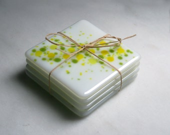 Handmade fused art glass coasters. 'Cosmos - Zesty'  Vibrant yellow and green on a white base. Choose a pair or a set of 4.
