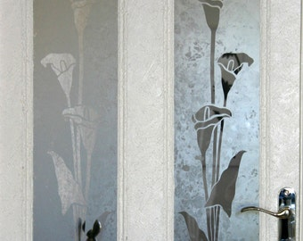 Original design 'Calla Lily' Acid etched glass door panels. Matching pair for panelled doors. Clear design on exclusive 'mottled' background