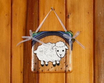 Hand painted, fused glass hanging ornament. 'Rainbow Baa Lamb' Cute baby lamb under a rainbow 10x10cm / 4x4 inches plus hanging ribbon