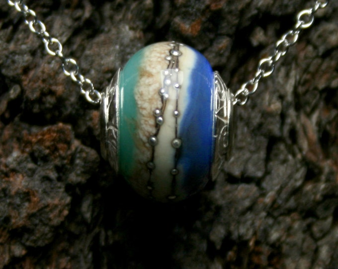 Stormy Seas ~ Lampwork big hole Focal bead. Hand made full sterling silver core & caps. Fine silver wrapped. Organic. Translucent warm blues