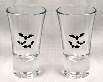 Bat Shot in Black - Pair of hand enameled shot glasses featuring a trio of beautiful black bats. Dishwasher safe!