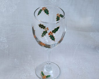 Holly Berry - An exclusive design, hand painted, wine glass featuring pairs of gold edged holly leaves and berries encircling the bowl.