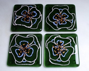 Kiln Fused glass coasters. 'Viola'  Hand painted large pink and mauve flowers with black golden tipped stamens on an olive green glass base.