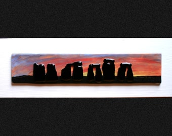 "Stonehenge Sunset #1 Fused glass 'painting' raised 'stones' on a hand painted sunset background, set on a white frame. 34 x 10cm (13.5 x 4"")"