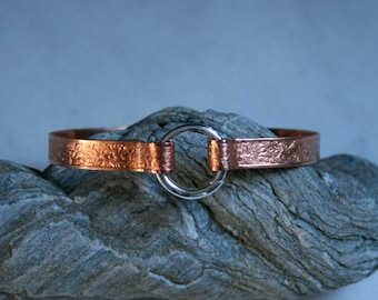 Copper BDSM cuff bracelet. Patterned copper band  with sterling silver captive 'O' ring closure. Choose pattern. Can be engraved :-)